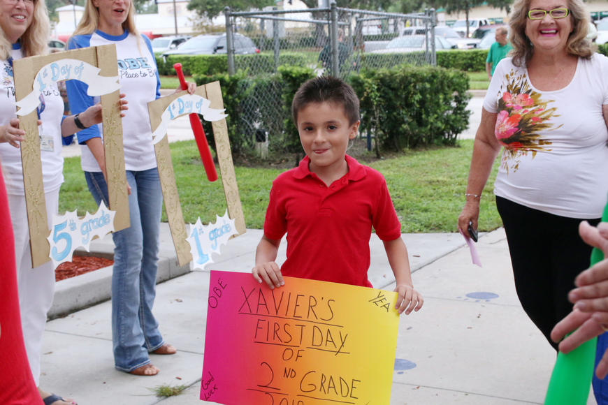 Xavier Guerra shows off his poster on the first day of school at Ormond Beach Elementary on Monday, Aug. 13. Photo by Jarleene Almenas
