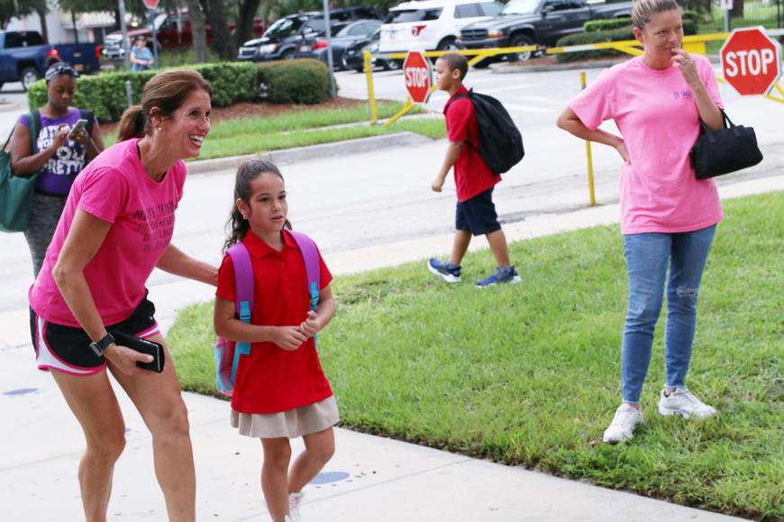 Rebecca Fazio walks into school with her daughter McKenzie on the first day of school at Ormond Beach Elementary on Monday, Aug. 13. Photo by Jarleene Almenas