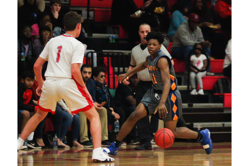 Jordan Sears drives past a Seabreeze defender. File photo