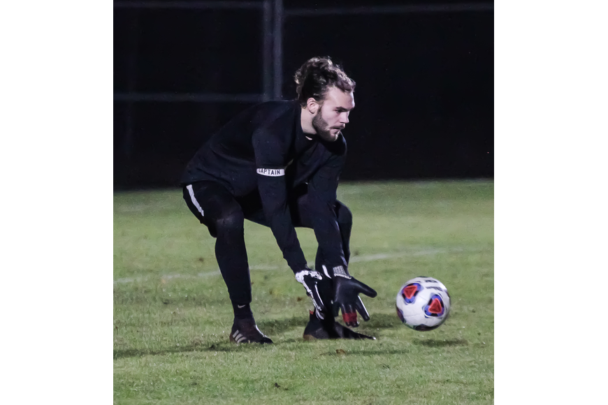 Seabreeze goalie scoops up a ball against Taylor. Photo by Ray Boone