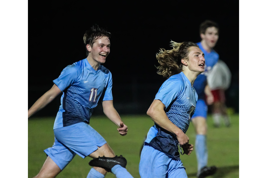 Seabreeze's Connor Rioux (No. 7) celebrates after scoring a goal. Photo by Ray Boone