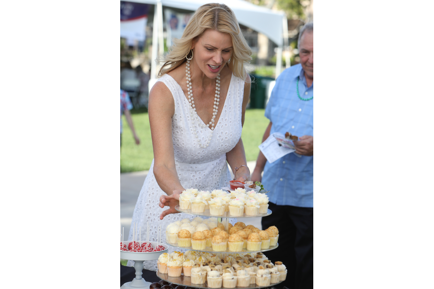 Jules Cox, of Ormond Beach, chooses her dessert after some careful consideration during the sixth-annual Taste of Ormond event on Sunday, March 3,  at the Casements. Photo by Anthony Boccio