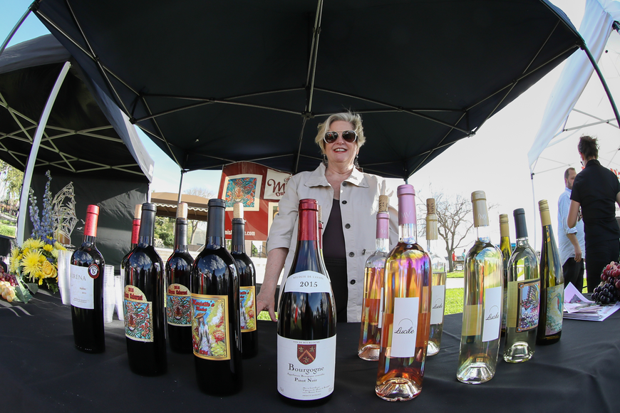 Sue Barry, of Daytona Beach and manager of S.R. Perrott, poses with her selection of adult beverages during the sixth-annual Taste of Ormond event on Sunday, March 3,  at the Casements. Photo by Anthony Boccio