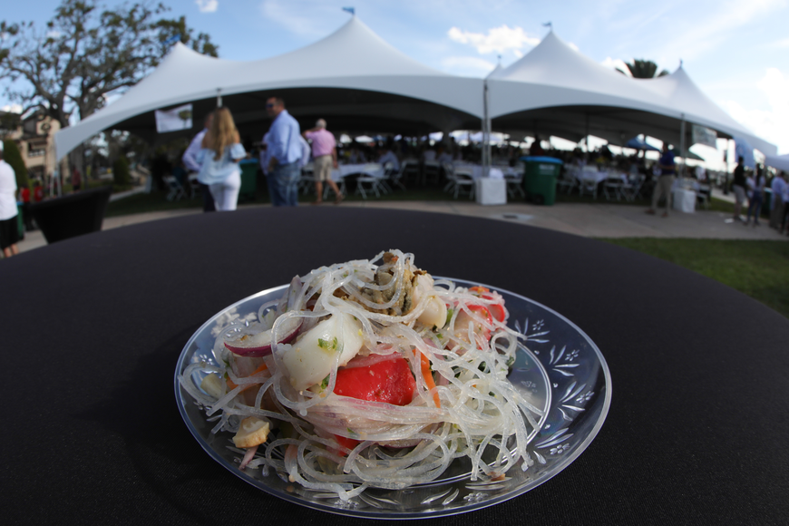 A glass noodle dish by Thai Woodhouse in Ormond Beach dresses up an empty table at the sixth-annual Taste of Ormond event on Sunday, March 3,  at the Casements. Photo by Anthony Boccio