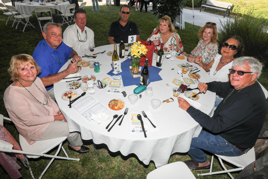 A group takes a break from their dining experience for a photo during the sixth-annual Taste of Ormond event on Sunday, March 3,  at the Casements. Photo by Anthony Boccio