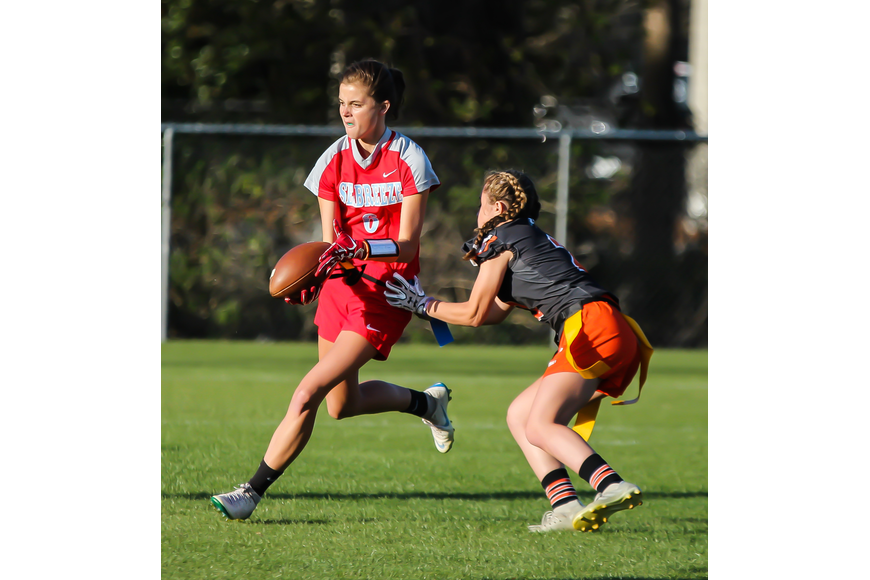 The Sandcrabs' Kara Haas attempts to shuffle a pass to a nearby teammate. Photo by Ray Boone