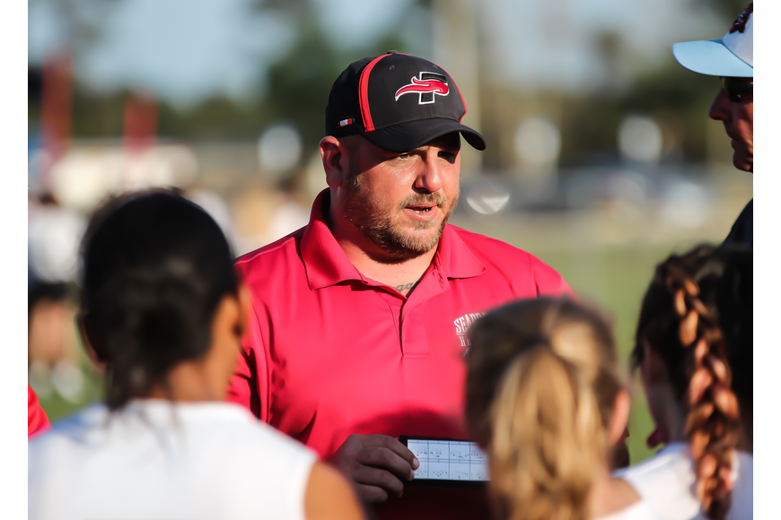 Seabreeze coach Mike Fries addresses his team during a timeout. Photo by Ray Boone