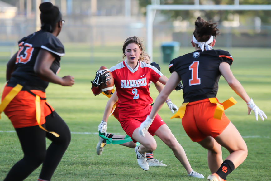 Seabreeze's Giuliana Klioze splits a pair of Hawks defenders. Photo by Ray Boone