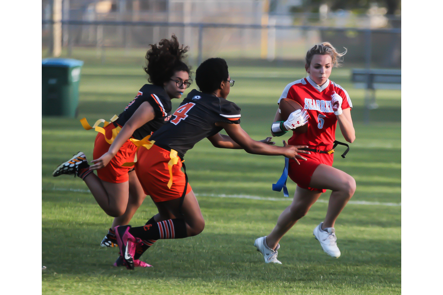 Seabreeze's Alihya Hahn sprints past a Hawks defender. Photo by Ray Boone