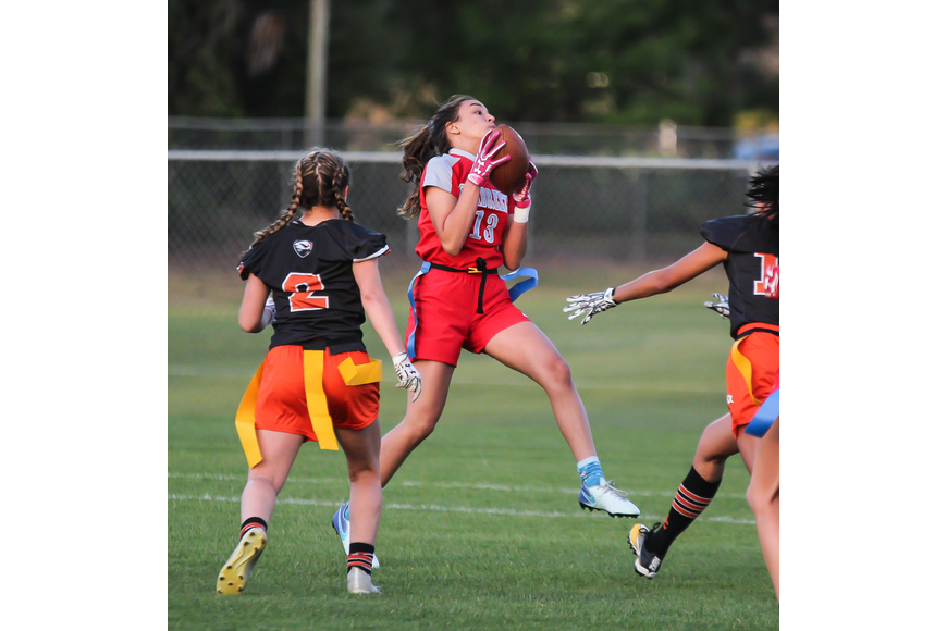 Seabreeze's Kara Haas brings down an interception against the Hawks. Photo by Ray Boone