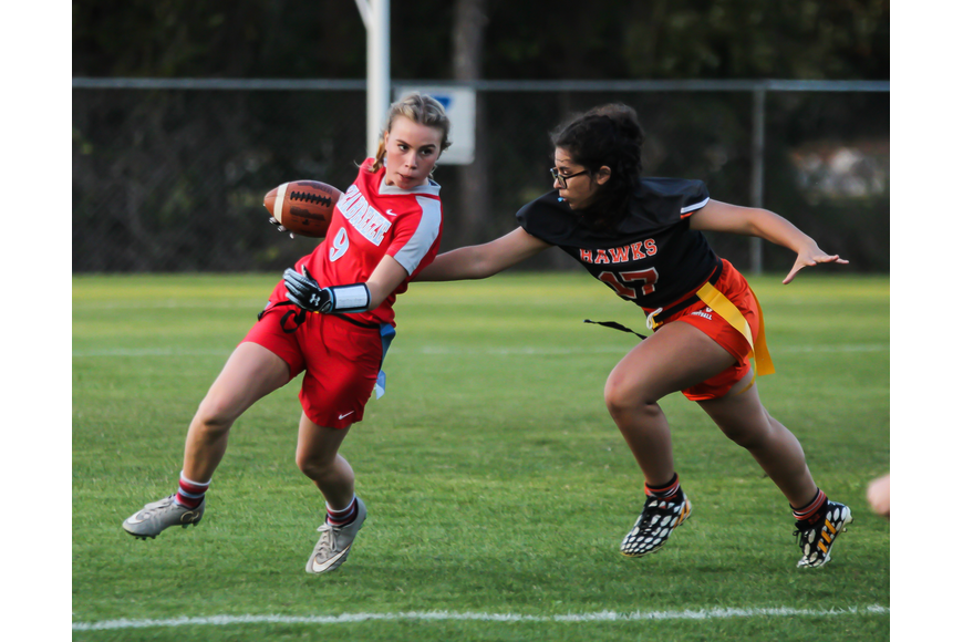 Seabreeze's Alihya Hahn tries to escape a Hawks defender. Photo by Ray Boone