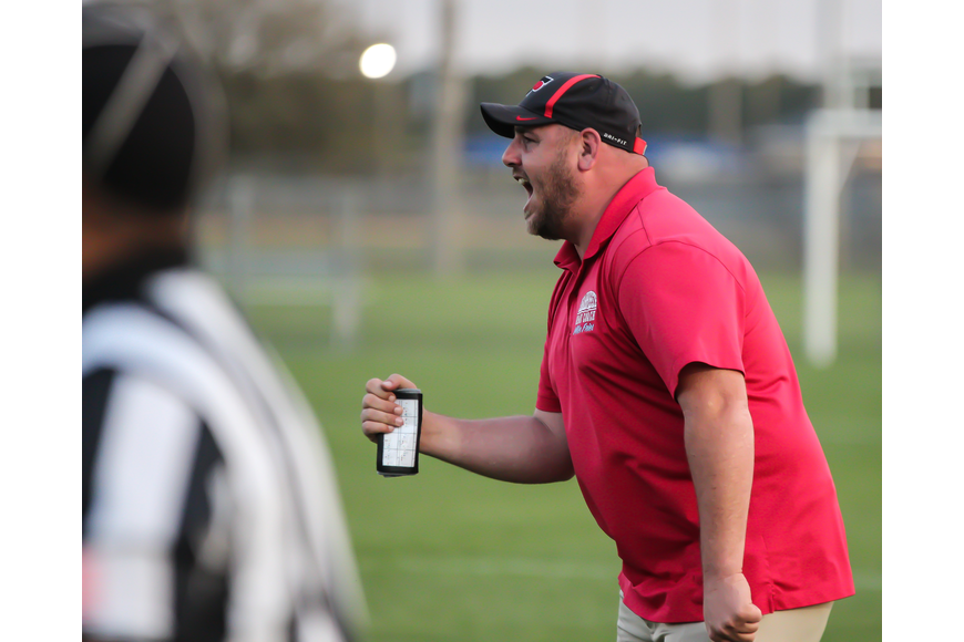 Seabreeze coach Mike Fries calls out a play against the Hawks. Photo by Ray Boone