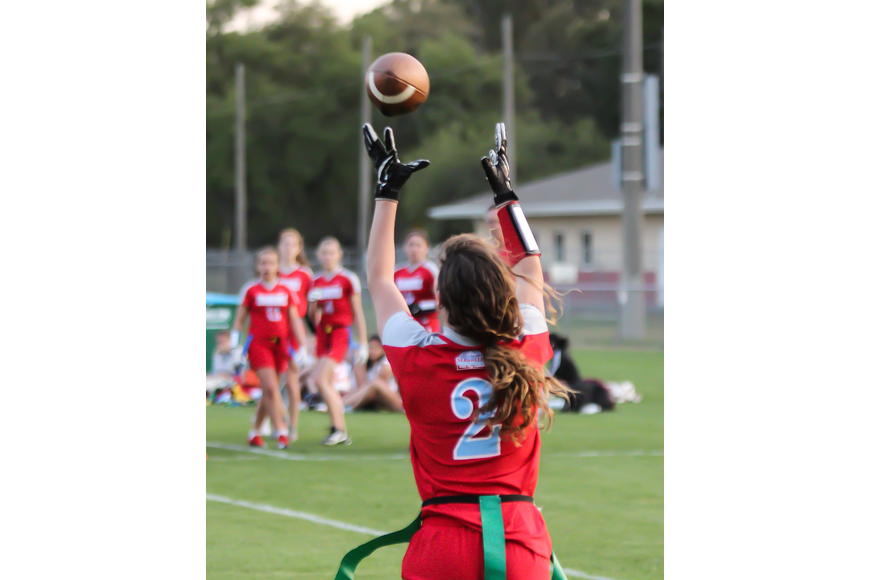 Seabreeze's Giuliana Klioze hauls in a touchdown pass against Spruce Creek. Photo by Ray Boone