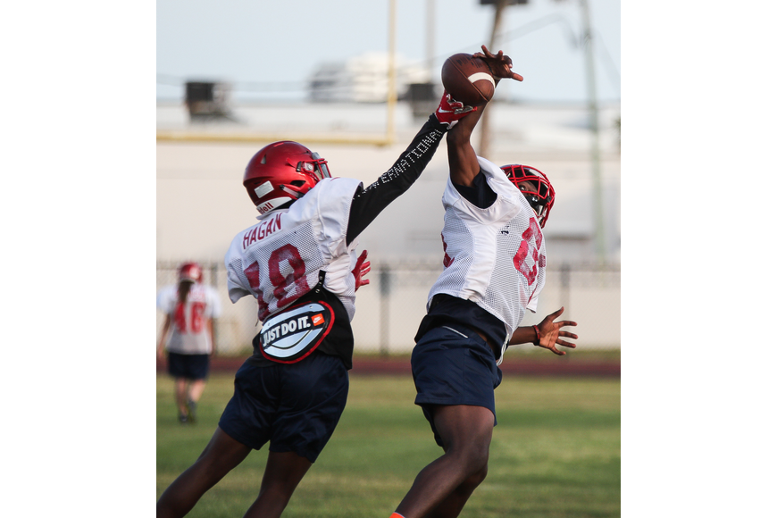 Seabreeze's Trae Bass (left) deflects a pass intended for Chris Lewis. Photo by Ray Boone