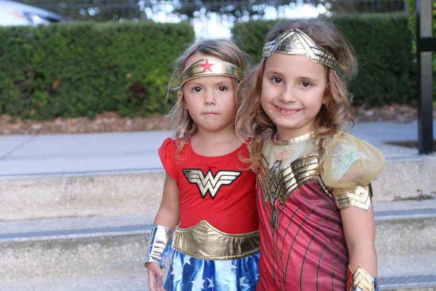 Brooke and Leah Bagwell sported Wonder Woman costumes at the Movies at the Halifax event at Rockefeller Gardens on Friday, Oct. 4. Photo by Jarleene Almenas