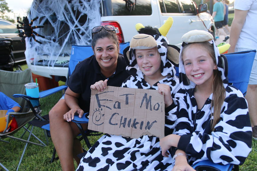Realty Pros realtor Rani Kelly and daughters Lawton and Pearl brought a little taste of Chick-fil-A to the Movies at the Halifax event at Rockefeller Gardens on Friday, Oct. 4. Photo by Jarleene Almenas