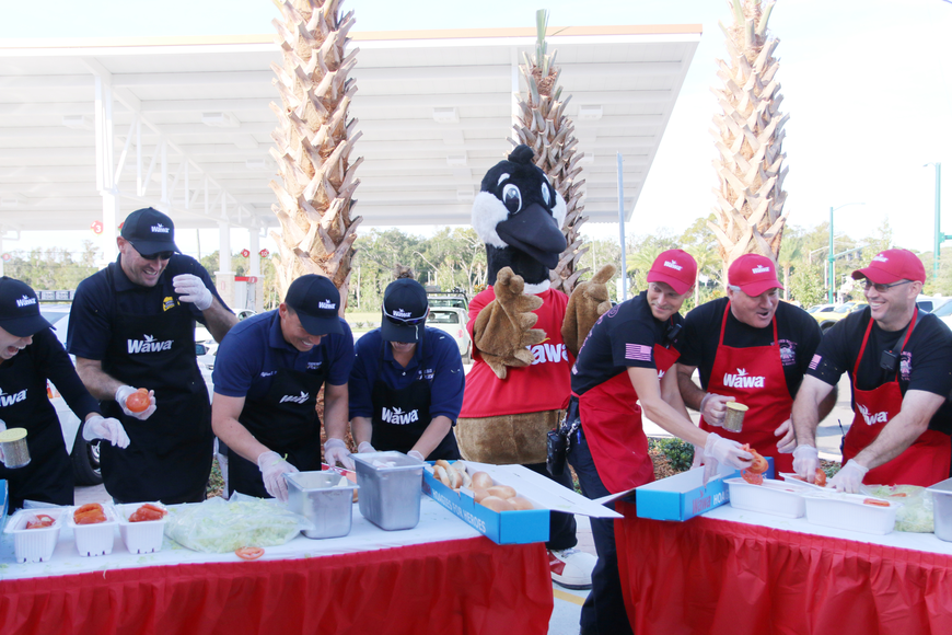 The Ormond Beach Police and Ormond Beach Fire Department teams compete in the Hoagies for Heroes contest during the Wawa grand opening on Thursday, Oct. 17. Photo by Jarleene Almenas