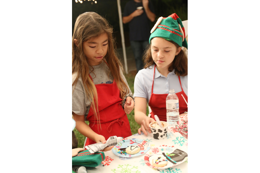 Girl Scouts Lynn Taylor and Kayla Tatro decorate cookies at the 41st-annual Christmas Gala at the Casements on Friday, Dec. 6. Photo by Jarleene Almenas
