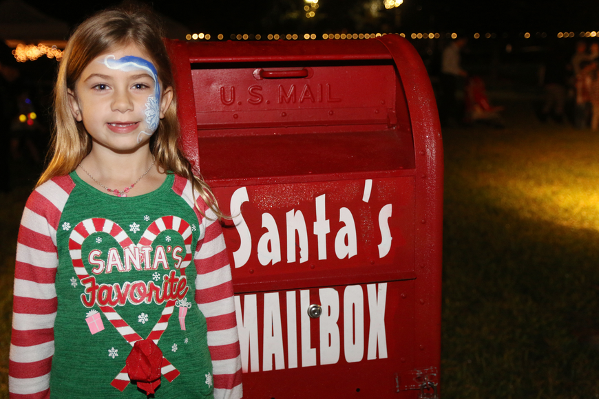 Madison Hinker poses by Santa's mailbox at the 41st-annual Christmas Gala at the Casements on Friday, Dec. 6. Photo by Jarleene Almenas
