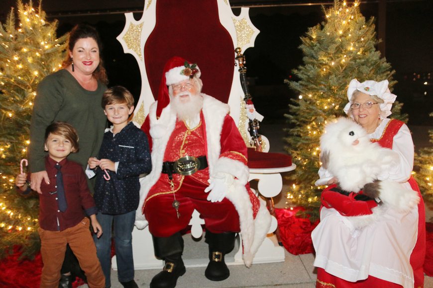 Sebastian, Shannon and Christian Benes meet Santa and Mrs. Claus at the 41st-annual Christmas Gala at the Casements on Friday, Dec. 6. Photo by Jarleene Almenas
