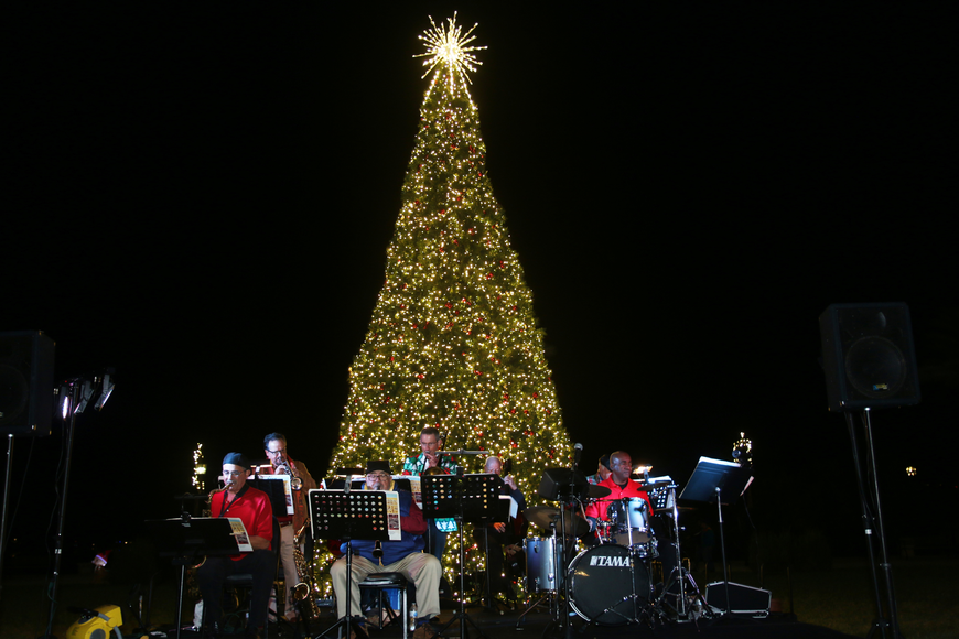 A band plays in front of the Christmas Tree during the 41st-annual Christmas Gala at the Casements on Friday, Dec. 6. Photo by Jarleene Almenas
