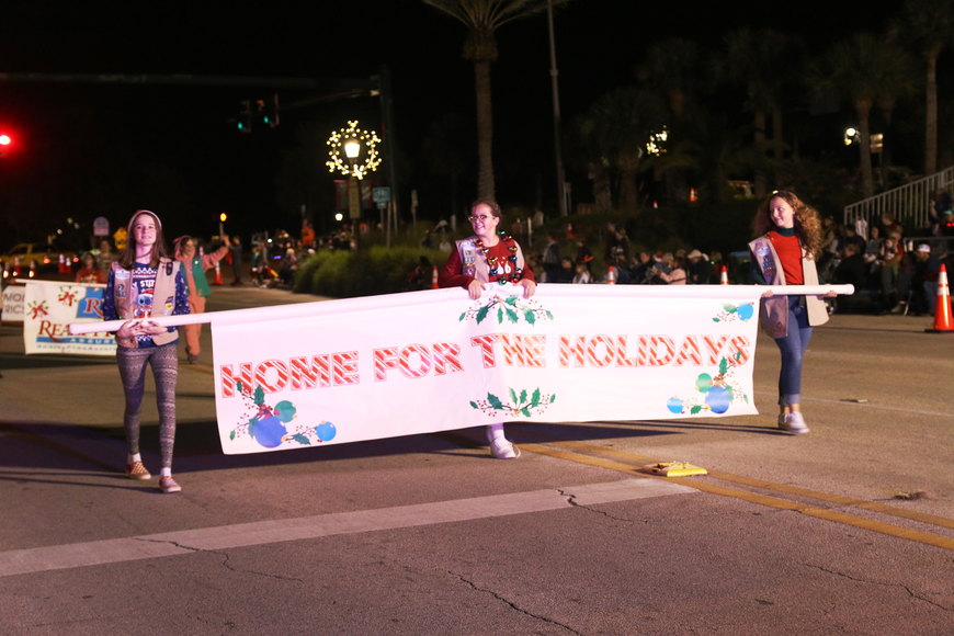 The Girl Scouts lead the beginning of the Home for the Holidays parade, held on Saturday, Dec. 14. Photo by Jarleene Almenas