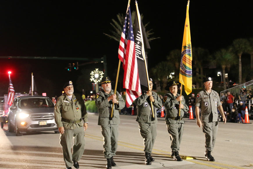 The Vietnam Veterans of America Daytona Beach Chapter 1048 walk the Home for the Holidays parade, held on Saturday, Dec. 14. Photo by Jarleene Almenas