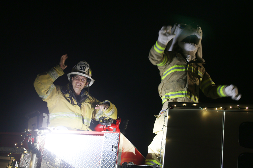Ormond Beach Fire Department Battalion Commander Nate Quartier rides fire engine with a Dalmatian mascot at the Home for the Holidays parade, held on Saturday, Dec. 14. Photo by Jarleene Almenas