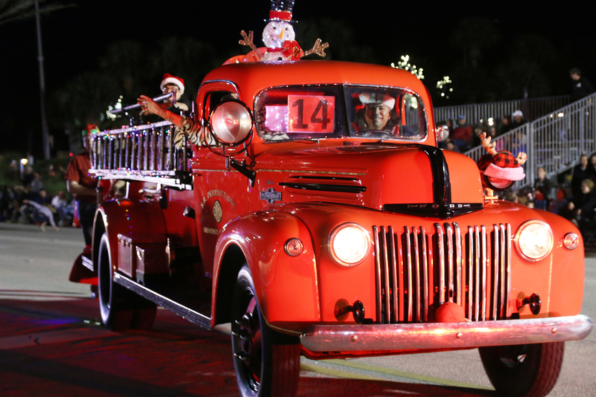 S.R. Perrott showcases its vintage fire engine at the Home for the Holidays parade, held on Saturday, Dec. 14. Photo by Jarleene Almenas