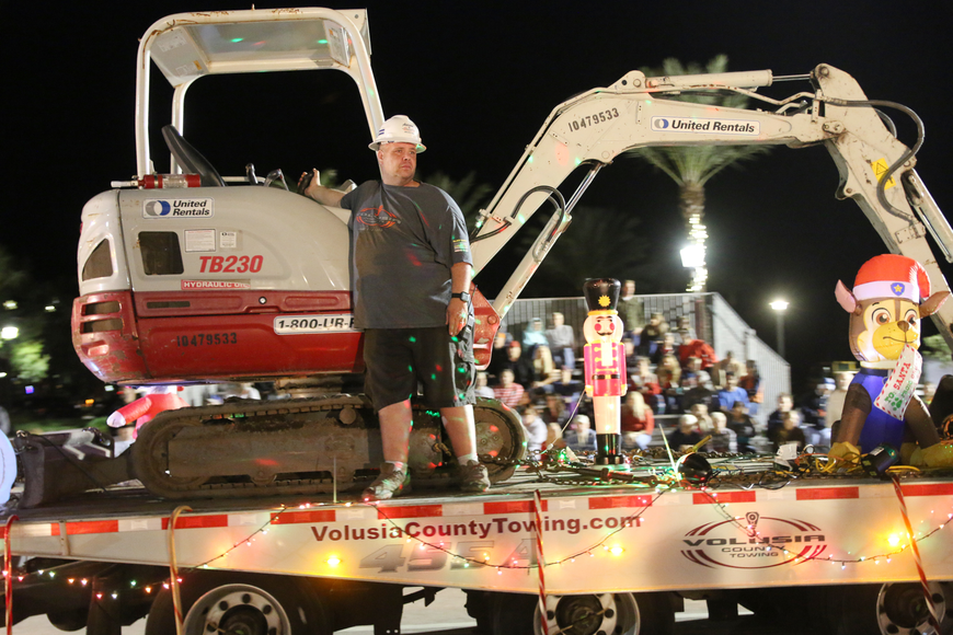 Volusia County Towing takes part of the Home for the Holidays parade, held on Saturday, Dec. 14. Photo by Jarleene Almenas