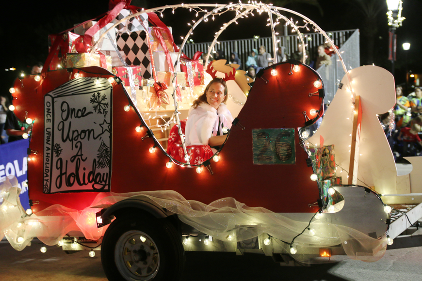 Osceola Elementary's Teacher of the Year Sarah Johns rides in a float during the Home for the Holidays parade, held on Saturday, Dec. 14. Photo by Jarleene Almenas