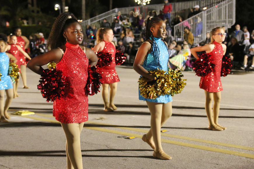 The Champion Elementary Honey Bears perform a  routine before parade judges at the Home for the Holidays parade, held on Saturday, Dec. 14. Photo by Jarleene Almenas