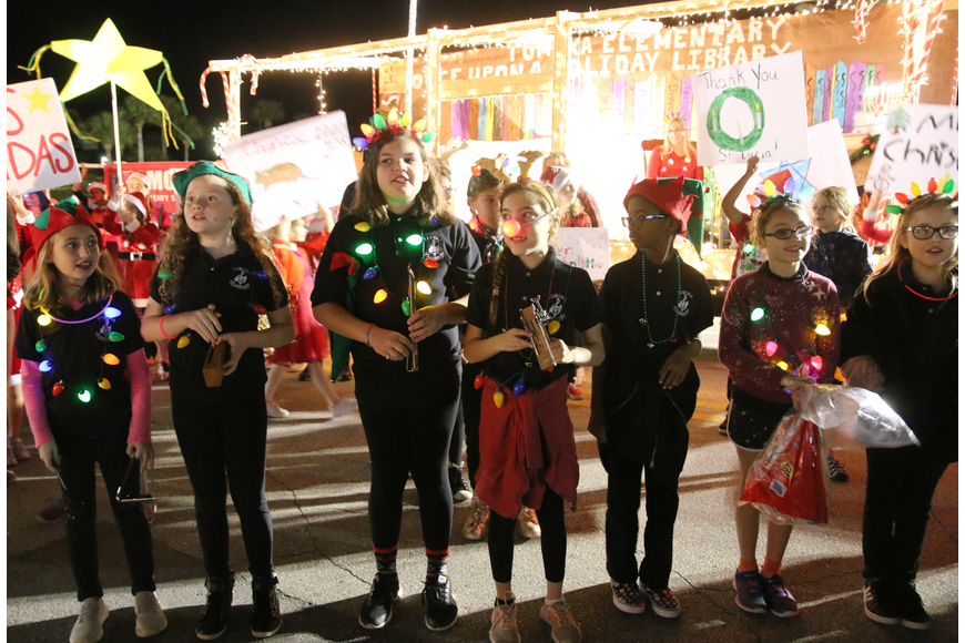 Tomoka Elementary students sing a song before parade judges at the Home for the Holidays parade, held on Saturday, Dec. 14. Photo by Jarleene Almenas