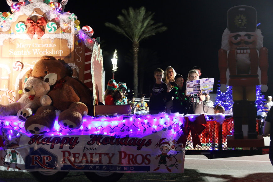 Realty Pros Assured takes part in the Home for the Holidays parade, held on Saturday, Dec. 14. Photo by Jarleene Almenas