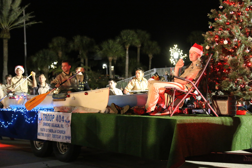 Boy Scout Troop 404 takes part in the Home for the Holidays parade, held on Saturday, Dec. 14. Photo by Jarleene Almenas