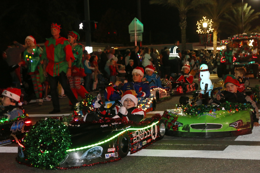 Children in go-karts rev down the street for the Home for the Holidays parade, held on Saturday, Dec. 14. Photo by Jarleene Almenas