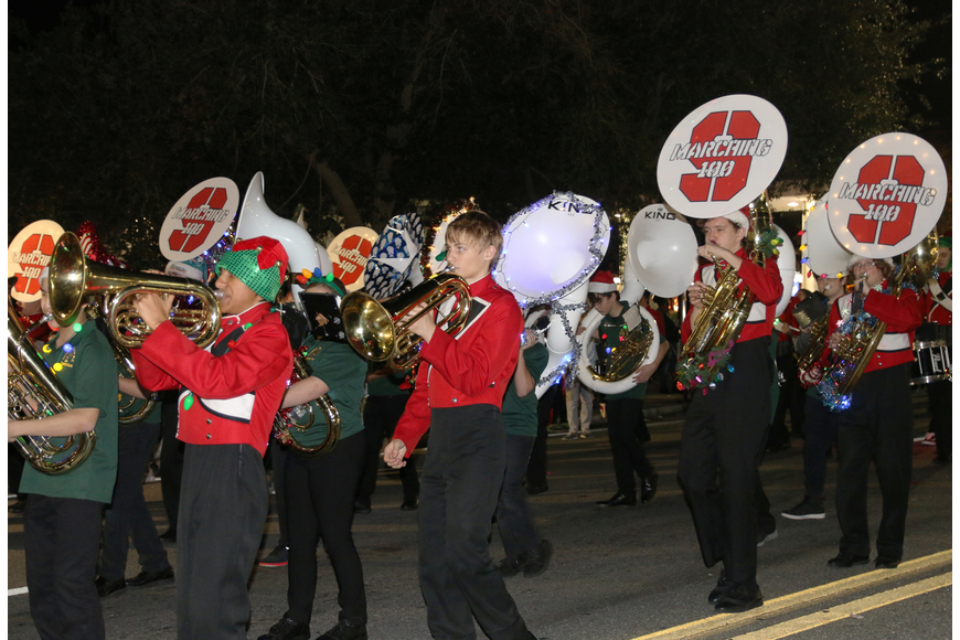 The Seabreeze High School Marching Band makes its way to the parade judges during the Home for the Holidays parade, held on Saturday, Dec. 14. Photo by Jarleene Almenas