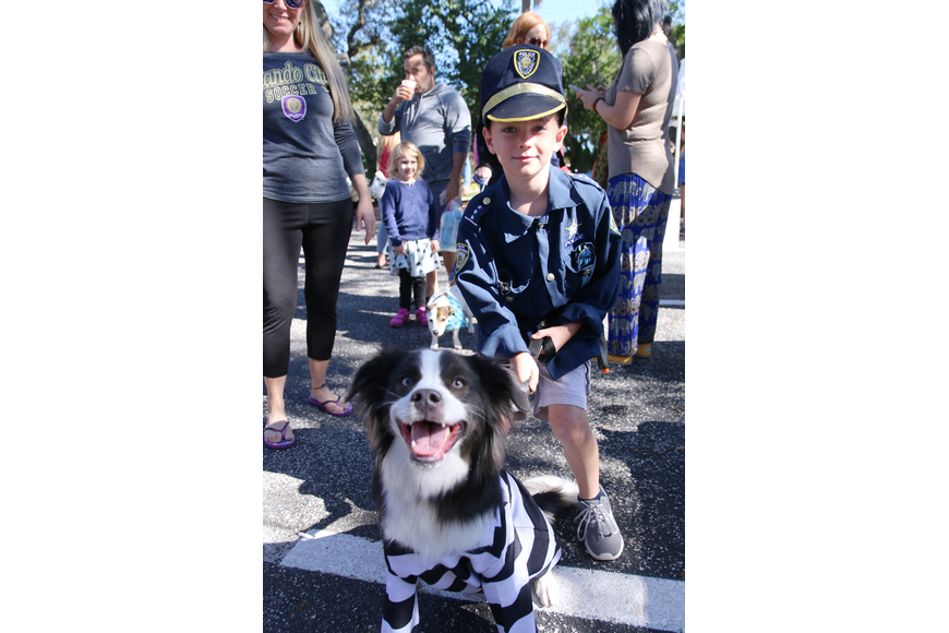 Matthew Williams, of Ormond Beach, and Patchouli, wear themed costumes in preparation of OMAM's Dogapalooza 2020 costume contest on Saturday, Jan. 25. Photo by Jarleene Almenas