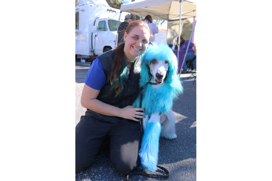 Sha Avants, dog trainer at Ormond Beach's Abracadabra Grooming and Pet Center, and Gambit. Photo by Jarleene Almenas
