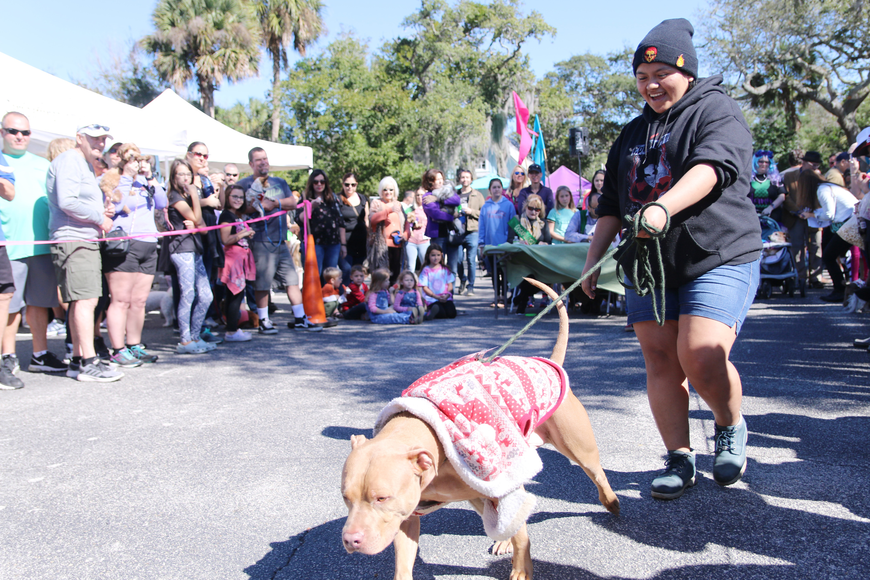 Genesis Hernandez, of Deltona, and King have fun during the costume contest at OMAM's Dogapalooza 2020 on Saturday, Jan. 25. Photo by Jarleene Almenas