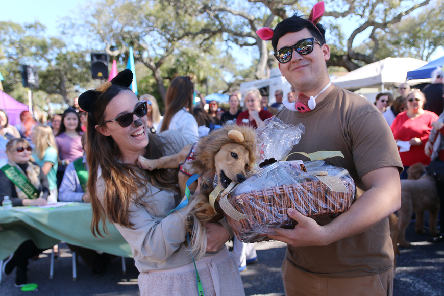 Katherine DeRosa and Izis Cordon, of Ormond Beach, with their hungry pup Winslow, who won the small dog costume contest at OMAM's Dogapalooza 2020 on Saturday, Jan. 25. Photo by Jarleene Almenas