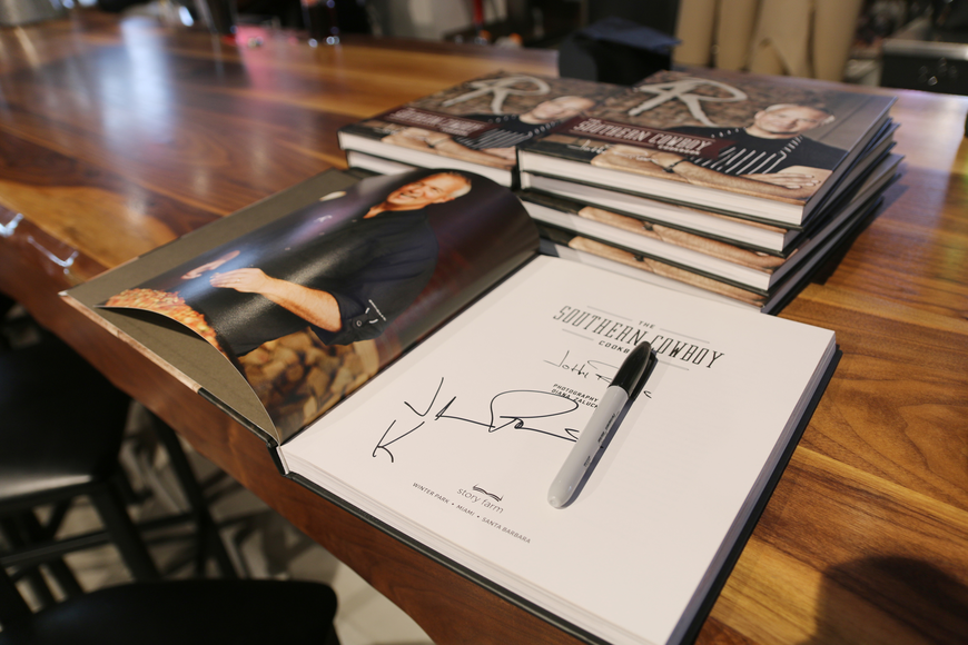 Signed cookbooks were available during the 4 Rivers media preview on Thursday, Feb. 6. Photo by Jarleene Almenas