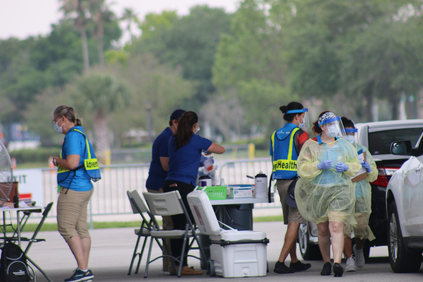 AdventHealth health care professionals work to test potential COVID-19 cases at the new testing site at the Daytona International Speedway. Photo by Jarleene Almenas