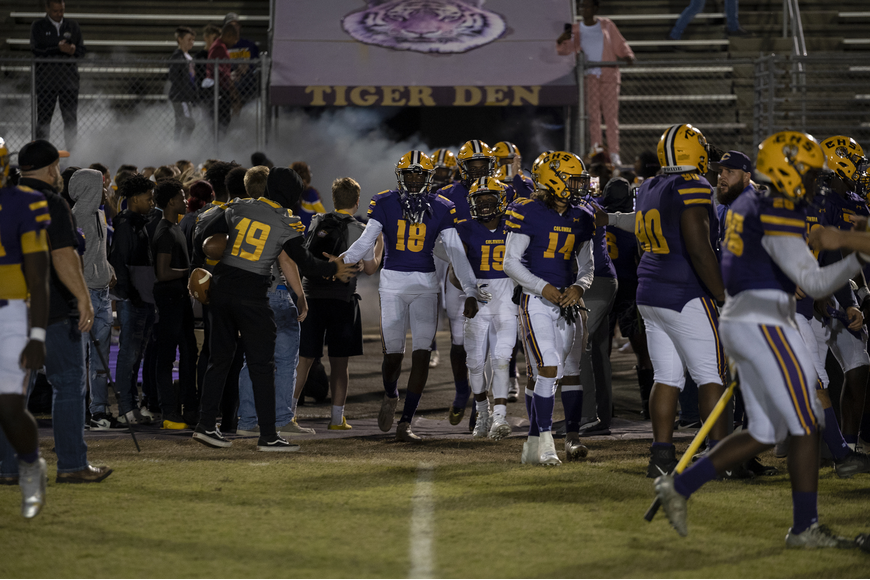 18 Marcus Peterson and 19 Leo Robinson emerge from the Tiger den with their teammates. Photos by Michele Meyers