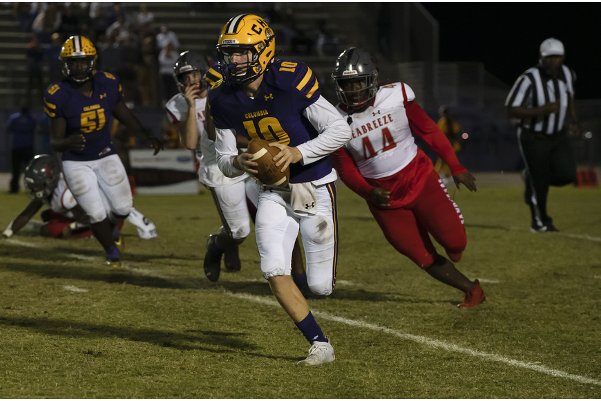 Tigers quarterback 10 Kade Jackson forced out of the pocket by 44 B.J. Glenn. Photos by Michele Meyers