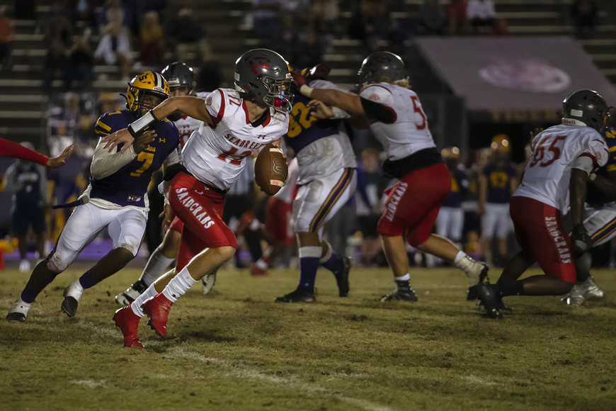 Seabreeze quarterback 12 Blake Boda making a run for it as 7 Adeon Farmer chases him down. Photos by Michele Meyers