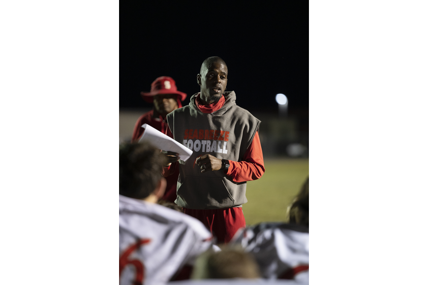 """You have all grown and I am proud of you,"" Coach Pat Brown quietly tells his team. Photos by Michele Meyers"