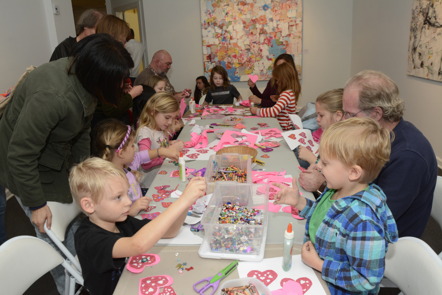 Families crowded into the arts and crafts room at Ormond Memorial Art Museum to make Valentine's for that special someone.