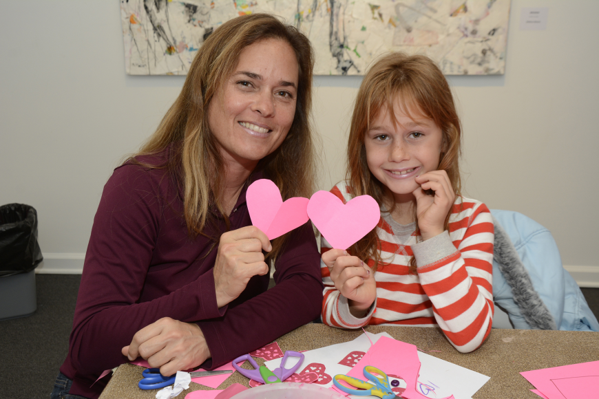Elana Carroll and her daughter Charlotte work together to make a Valentine's Day decoration.  Photos by Anastasia Pagello