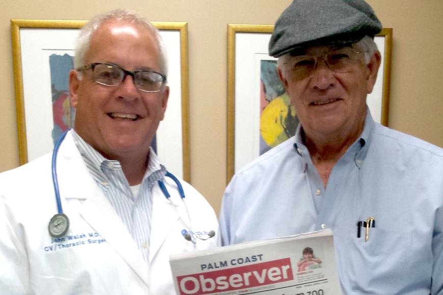 Publisher John Walsh, left, dons the white coat and stethoscope of heart surgeon Dr. John Walsh, right. Courtesy photo